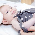 Dressing a newborn. Properly dressed babies